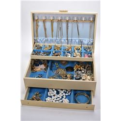 Vintage jewellery box filled with jewellery incuding necklaces, earrings, hinged bracelet, diamante