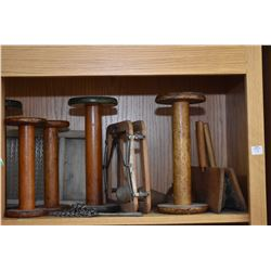 """Shelf lot of wooden and primitive collectibles including large spools, wool carders including """"Watso"""