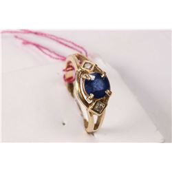 Ladies 14kt yellow gold, blue sapphire and diamond ring set with 0.75ct round faceted blue sapphire