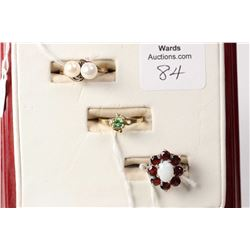 Three ladies rings including sterling silver, garnet and opal ring, ladies 10kt yellow gold and doub