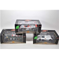 Three new in box 1:18 scale Maisto die cast collector cars including Audi R8, Porsche 911 GT1 and a