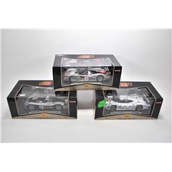Three new in box 1:18 scale Maisto die cast collector cars including Audi R8R, Audi R8 and a Porsche