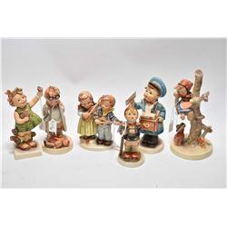 "Six Goebel Hummel figurines including ""Spring Cheer"" ""Postman"", ""Little Hiker"", ""Doll Doctor, ""Happy"