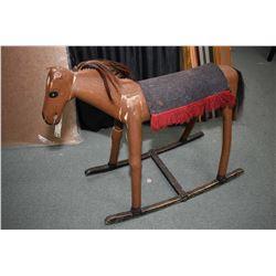 Vintage folk art rocking horse with saddle blanket