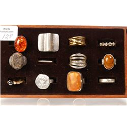 Twelve collectible and designer rings including sterling silver, amber gemstone etc.