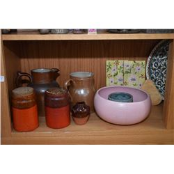 Shelf lot of pottery and ceramic items including pitcher's cannisters with cork stoppers, German mad