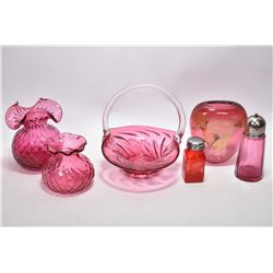 Selection of cranberry glass including two quilted vases with ruffled edges, basket with applied cle