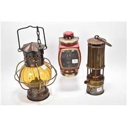 "Three vintage kerosene lamps including one marked ""Industrial Rubber Product Ltd. London, Indupro la"