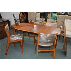 Danish made mid century modern teak dining table with three insert leaves, four matching chairs plus