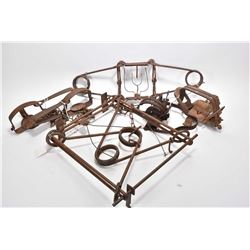 Six vintage small animal traps including three leg hold