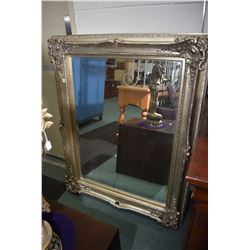 Large ornate silver framed bevelled wall mirror, overall size 42  X 52