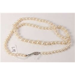 Ladies 20  strand of knotting graduating pearls with sterling silver clasp