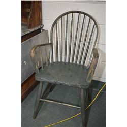 Antique spinning wheel and an antique spindle back arm chair