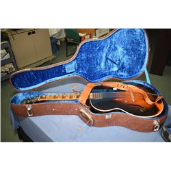 Two vintage musical instruments including a Melody King six string guitar in hard case and a violin