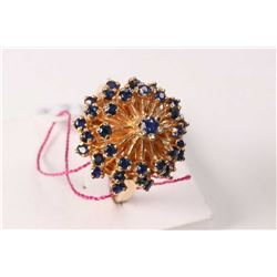Ladies 14kt yellow gold and sapphire gemstone dinner ring set with three tiers of round shaped facet