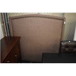Double sized fabric upholstered head board with nail head decoration