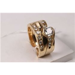 Ladies 14kt yellow gold and diamond engagement and soldered wedding rings. Engagement ring is set wi