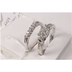 Ladies 14kt white gold and diamond ring set with six princess cut white diamonds of approximately .4