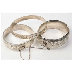 Three vintage chaised bracelet including a Birks hinged bracelet with British hallmarks, a silver ba