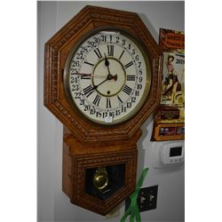 Antique oak cased wall mount clock with 31 day calendar and decorative visible pendulum