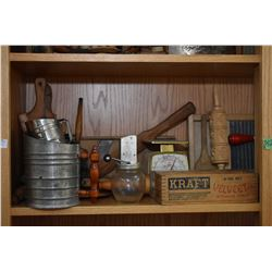 Shelf lot of vintage kitchen collectibles including glass butter churn, small mixer, scales, rolling