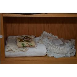 Shelf lot of vintage table linens including table linens, embroidered pieces, napkins etc.
