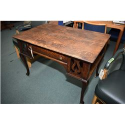 Antique quarter cut oak, single drawer writing desk on tall supports and book storage on each end