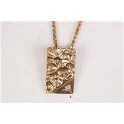 "Ladies 14kt yellow gold 16"" neck chain and a 10kt yellow gold pendant set with small accent diamond"