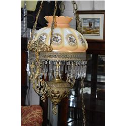 Antique hanging oil lamp converted to electric with figural cast decoration, replaced floral motif g