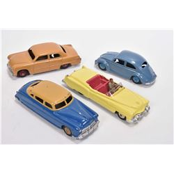 Four vintage Dinky Toys including Cadillac Eldorado # 131, Volkswagen # 181, Ford Sedan and a Hudson