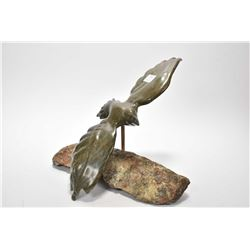 "Stone Inuit carving of a bird in flight on a stone base, 14"" wing span"