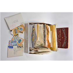 Selection of assorted collectible stamps and a stamp book