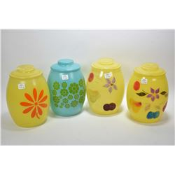 Four vintage hand painted glass lidded canisters