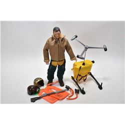 Vintage G.I. Joe action figure patented 1964 with accessories including helicopter back pack, two he