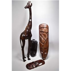 """Selection of treenware including three wall masks and a 35"""" carved giraffe"""