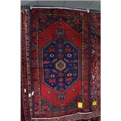 100% wool Iranian Zanjan area carpet with center medallion, red background, blue, green and copper h
