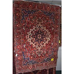 100% wool Iranian Bakhtiar area carpet with large center medallion with predominantly red background