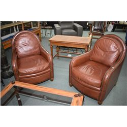Pair of modern leather arm chairs with naihead decoration made by Elite for Finesse Furnishings