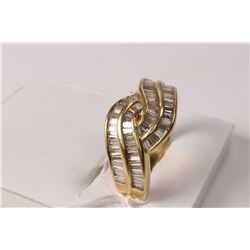 Ladies 18kt yellow gold and diamond ring set with 1.25ct of baguette cut white diamonds. Retail repl