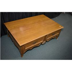 Semi-contemporary four drawer French style coffee table made by Ethan Allen