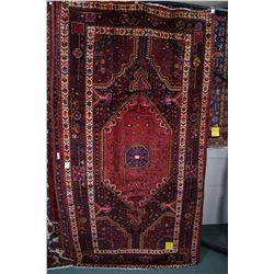 100% wool Iranian Nahavand area carpet with large center medallion, in tones of red, royal navy blue