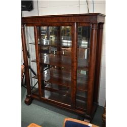Antique flame mahogany display cabinet with decorative column support and full 90 degree bend glass
