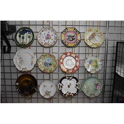 Twelve antique decorator plates including handpainted Limoges, Royal Vista pictorial plate, R. S pla