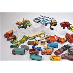 Two trays of vintage die cast toys including Lesney, Matchbox, Husky, Ertl, Tootsie etc.