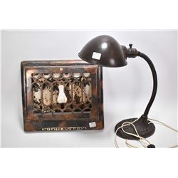 Vintage heating grate and a cast desk lamp