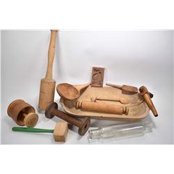 Selection of primitive kitchen treenware including dough bowl, butter molds, mallet, rolling pins et