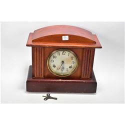 Antique chiming wood cased mantle clock made by Waterbury Clock Co. U.S.A, working at time of catalo