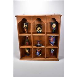 Wall mount four tier display with nine pieces of Tunstall handpainted semi-porcelain cabinet pieces