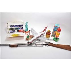 Selection of vintage toys including Air Canada DC 9 friction toy, Daisy No. 25 pump action BB gun, G