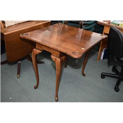 Mid 20th century games table on tall cabriole supports, note currently permanently in the open posit